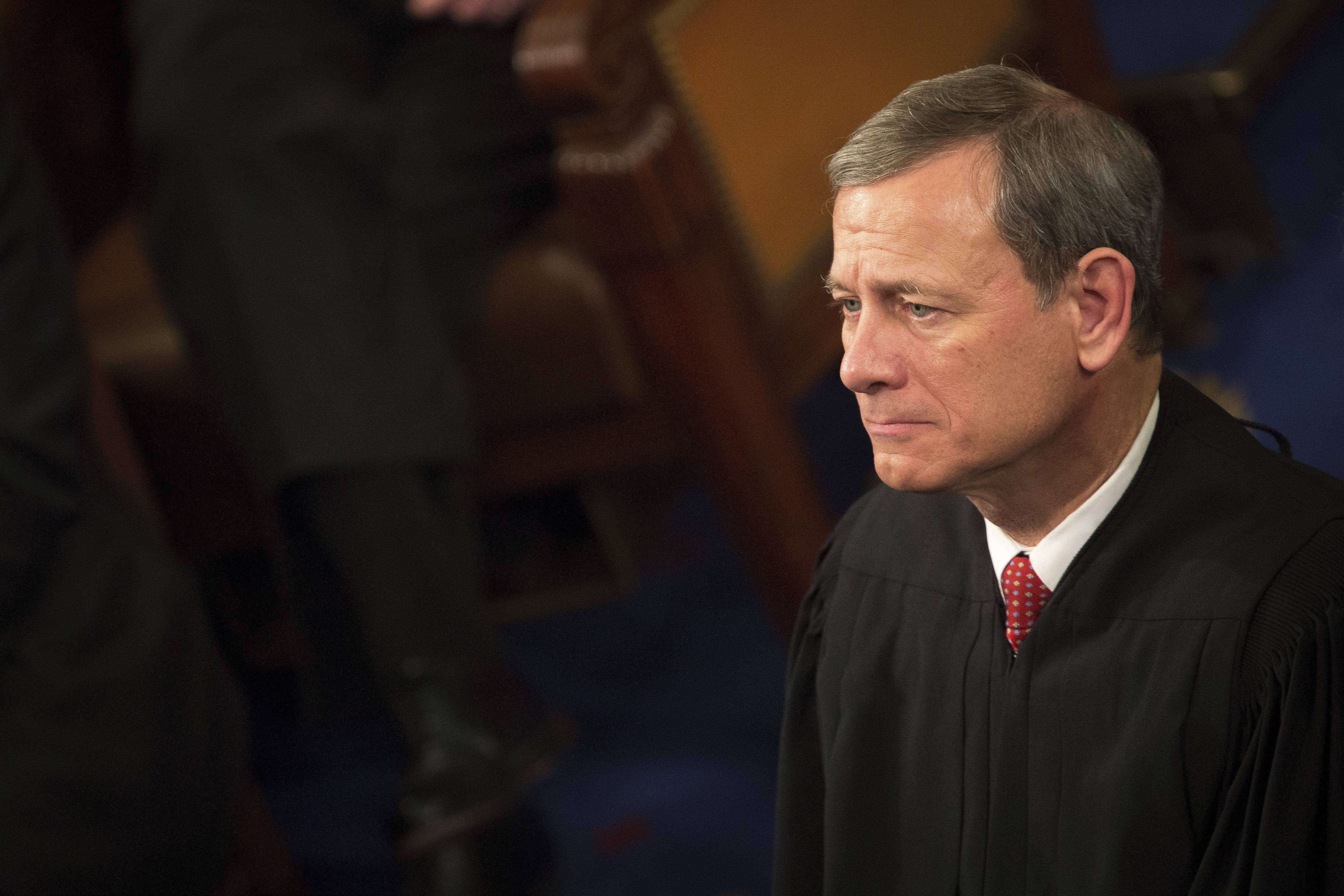 Chief Supreme Court Justice John Roberts listens as U.S. President Barack Obama delivers the State of the Union address to a joint session of Congress at the Capitol in Washington, D.C., U.S., on Tuesday, Jan. 12, 2016. Obama said he regrets that political divisiveness in the U.S. grew during his seven years in the White House and he plans to use his final State of the Union address Tuesday night to call for the nation to unite. Photographer: Drew Angerer/Bloomberg via Getty Images