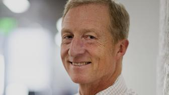 Thomas 'Tom' Steyer, founder and former chief executive officer of Farallon Capital Management LLC, stands for a photograph in San Francisco, California, U.S., on Wednesday, Oct. 8, 2014. As rising seas threaten Florida, billionaire Thomas Steyer is floating an $8.6 million campaign to save the state, opening 21 offices, deploying more than 500 staffers and volunteers and sending out a rolling ark. Photographer: David Paul Morris/Bloomberg via Getty Images