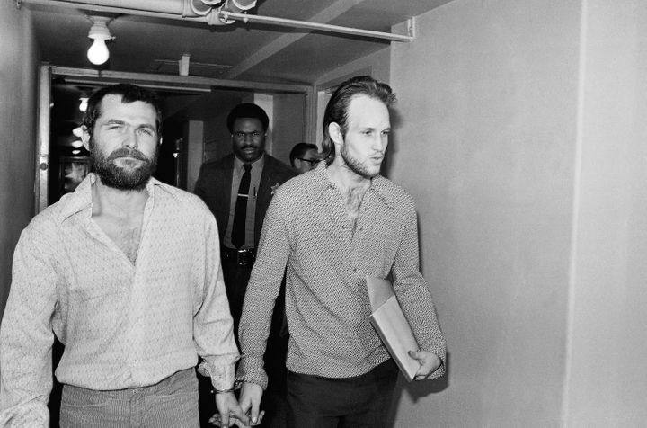 Two male members of the Charles Manson family, Bruce Davis, left, and Steve Grogan, leave court after a hearing on the appoin