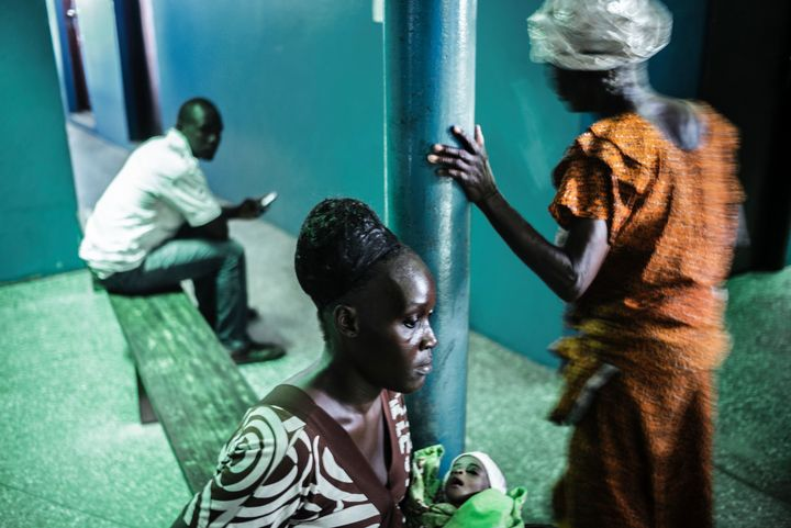 A woman waits for a consultation at the Star of the Sun Health Centre in the Monrovia township of West Point on April 29, 2016.