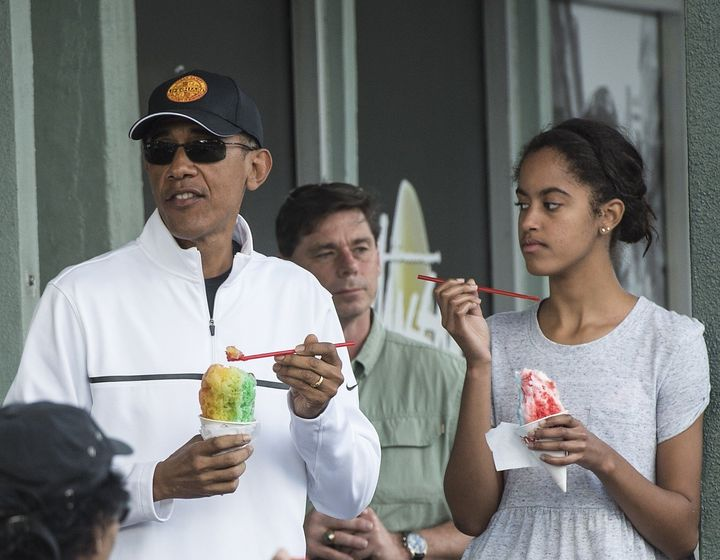 US President Barack Obama has shave ice with his daughter Malia at Island Snow in Kailua on January 1, 2015.