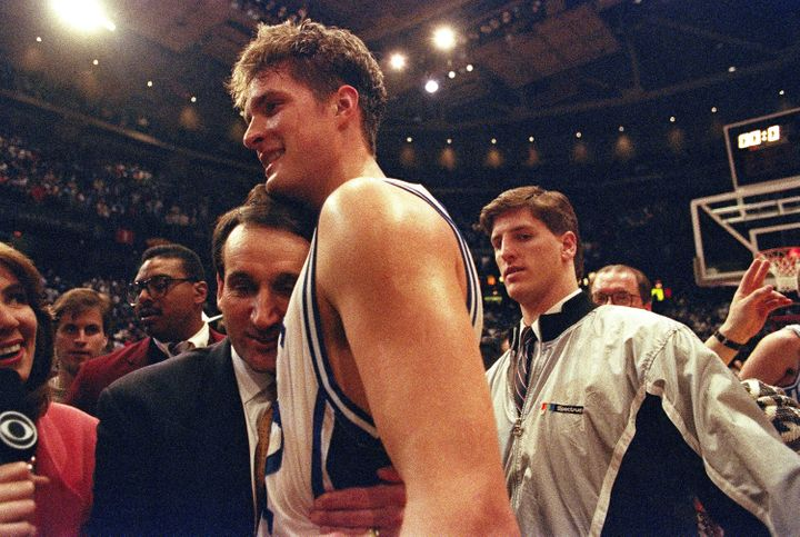Krzyzewski embraces Christian Laettner after he famously beat Kentucky with a program-defining buzzer-beater in the 1992 East