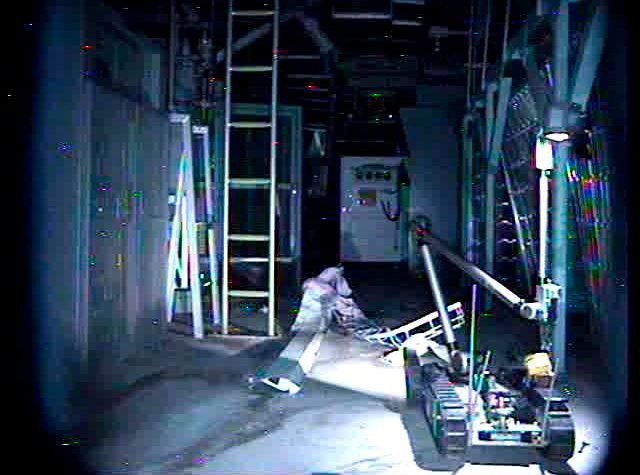 """A remote-controlled robot called """"Packbot"""", which is capable of manoeuvring through buildings, taking images and measuring radiation levels, is pictured by another """"Packbot"""" near the north side hydraulic control unit of the Tokyo Electric Power (TEPCO) Co.'s crippled Fukushima Daiichi Nuclear Power Plant No.3 reactor building in Fukushima Prefecture, May 10, 2011, in this handout photo released by TEPCO May 12, 2011. Japan's government agreed on Friday to set up a fund with taxpayer money to help Tokyo Electric Power compensate victims of the crisis at its tsunami-crippled nuclear plant and avoid financial collapse. Mandatory Credit REUTERS/Tokyo Electric Power Co/Handout (JAPAN - Tags: DISASTER ENERGY BUSINESS SCI TECH) FOR EDITORIAL USE ONLY. NOT FOR SALE FOR MARKETING OR ADVERTISING CAMPAIGNS. THIS IMAGE HAS BEEN SUPPLIED BY A THIRD PARTY. IT IS DISTRIBUTED, EXACTLY AS RECEIVED BY REUTERS, AS A SERVICE TO CLIENTS. MANDATORY CREDIT"""