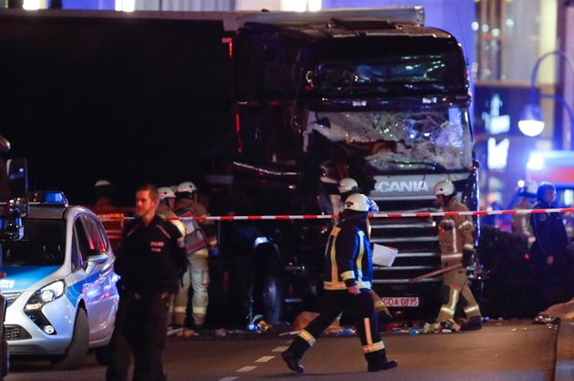A firefighter walks in front of a truck at the site of an accident at a Christmas market on Breitscheidplatz...