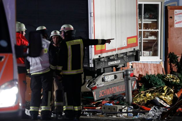 Firefighter stand beside a truck at a Christmas market in Berlin,