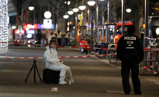 A German police investigator rests at a Christmas market following an accident with a
