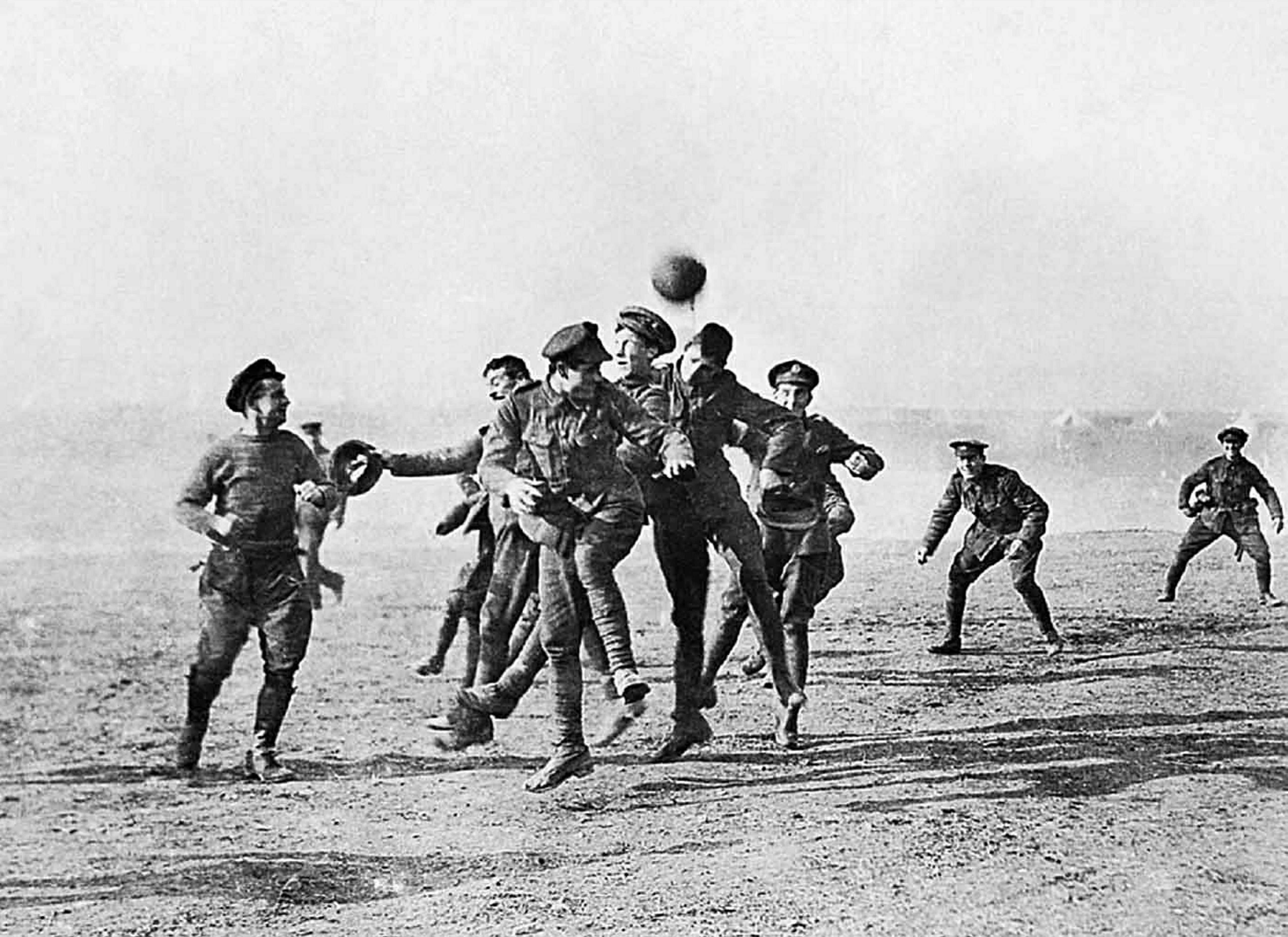 Soldiers play football in No-Man's Land during the Christmas Truce of
