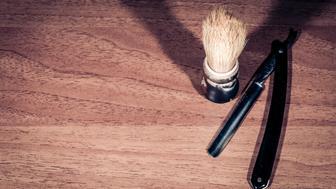 Shaving brush and razor blade. Retro. Selective focus.