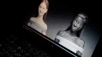 """An online advertisement by Thai cosmetics company Seoul Secret showing Thai actress Cris Horwang, right, is displayed on a computer screen in Bangkok, Thailand, Friday, Jan. 8, 2016. The company has pulled a video in which the Thai movie star wears blackface and promotes a skin-whitener with the slogan: """"You just need to be white to win."""" Seoul Secret issued a """"heartfelt apology,"""" saying in a statement it had had no intention to convey racist messages. (AP Photo/Charles Dharapak)"""