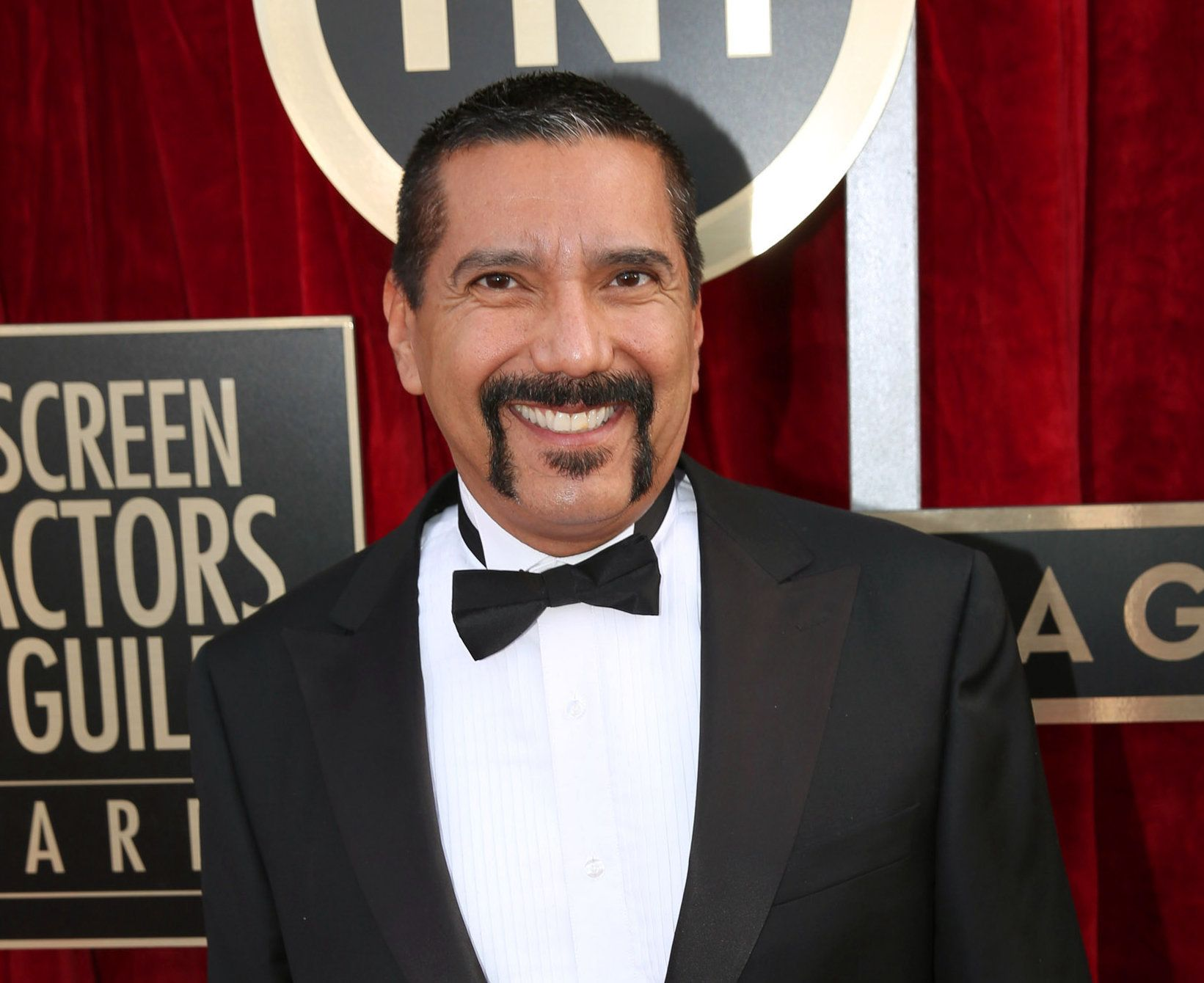 "FILe - In this Jan. 18, 2014 file photo, Steven Michael Quezada an actor on the series ""Breaking Bad,"" arrives at the 20th annual Screen Actors Guild Awards in Los Angeles. Quezada is jumping in a race for a heated county commissioner seat in Albuquerque. Quezada, who played DEA agent Steven Gomez in the hit AMC-TV series ""Breaking Bad"", said Monday, July 20, he will announce this week that he will run for the Bernalillo County Commission. (Photo by Matt Sayles/Invision/AP, File)"