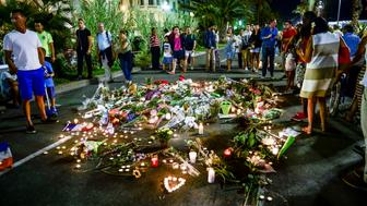 PA REVIEW OF THE YEAR. File photo dated 16/07/16 of tributes being placed where bodies fell on the Promenade des Anglais, Nice, where more than 80 people were killed when a French-Tunisian father-of-three drove a lorry into crowds celebrating Bastille Day.