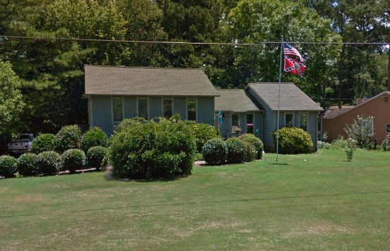 A Confederate flag is seen flying outside of the former Roswell Police Sergeants home last year