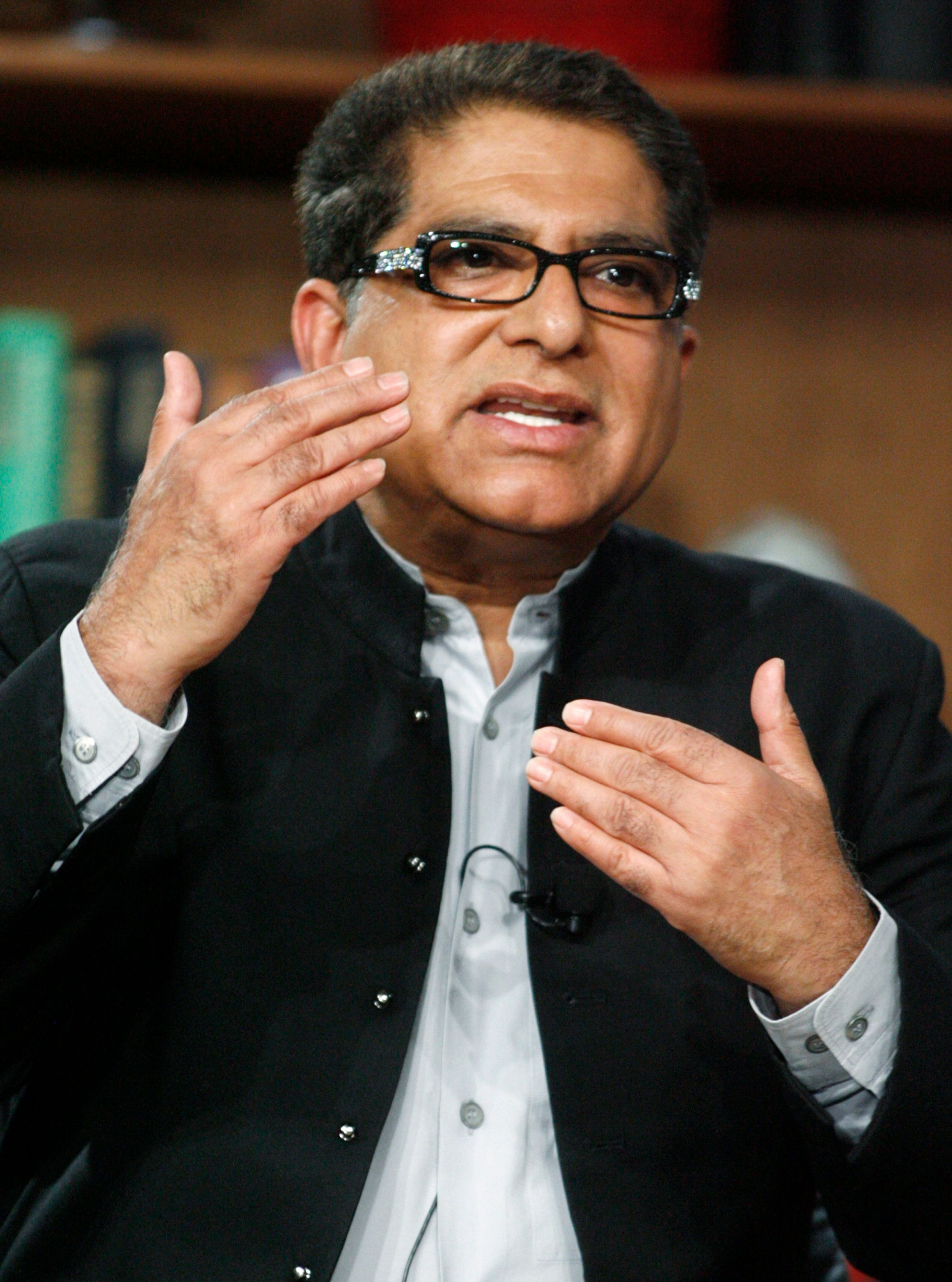 "Deepak Chopra, co-founder and president of Alliance for a New Humanity, speaks at a panel discussion ""Alternative Medicine Joins the Mainstream"" at the 2009 Milken Institute Global Conference in Beverly Hills,California April 28, 2009.  REUTERS/Fred Prouser    (UNITED STATES HEALTH BUSINESS)"