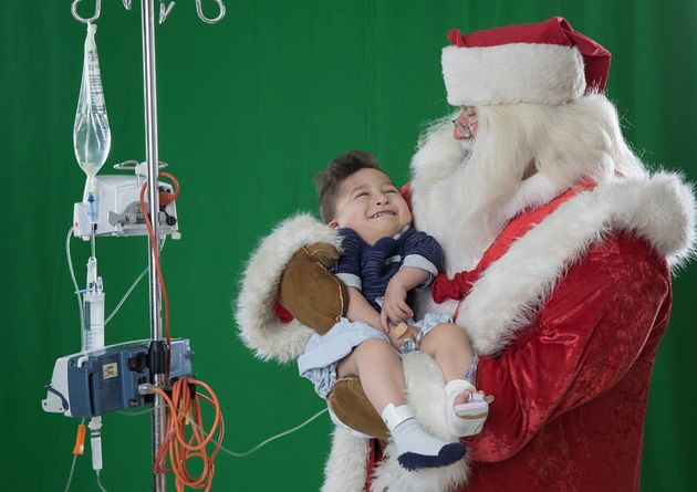 Santa Takes Sick Children To Christmas Wonderlands In Magical Photo