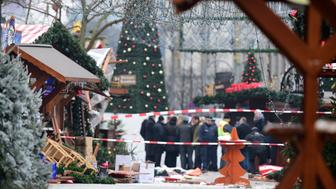 A view of the Christmas market near the Kaiser-Wilhelm-Gedaechtniskirche (Kaiser Wilhelm Memorial Church), the day after a terror attack, in central Berlin, on December 20, 2016. German police said they were treating as 'a probable terrorist attack' the killing of 12 people when the speeding lorry cut a bloody swath through the packed Berlin Christmas market. / AFP / Tobias SCHWARZ        (Photo credit should read TOBIAS SCHWARZ/AFP/Getty Images)