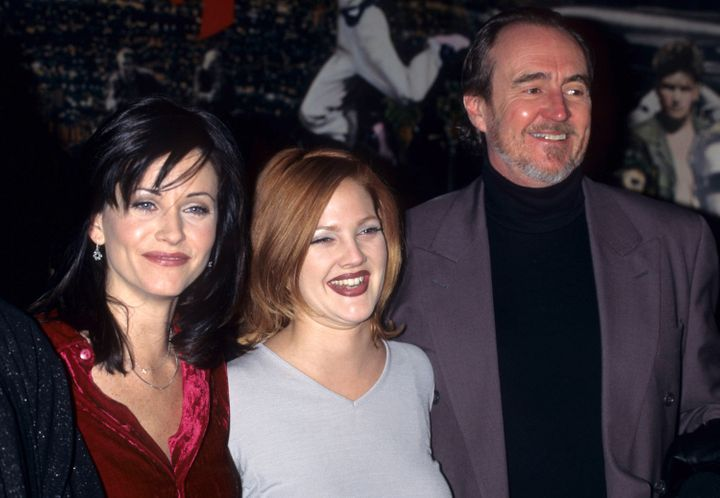 "Courteney Cox, Drew Barrymore and Wes Craven attend a ""Scream"" screening in December 1996."