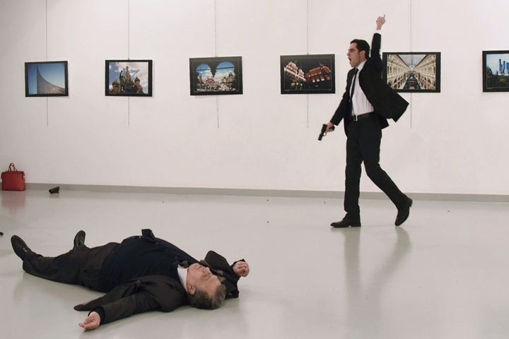 A gunman crying 'Aleppo' and 'revenge' shot Karlov while he was visiting an art exhibition in Ankara on December 19, witnesse