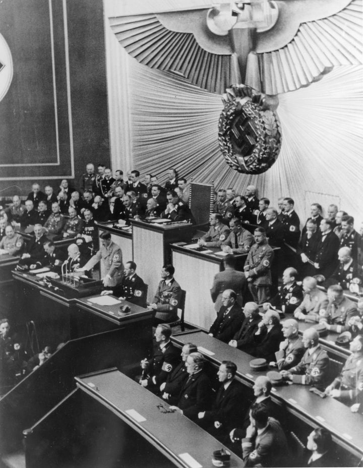 Hitler addresses the Reichstag in Berlin in 1938. Anton Reinthaller is in the first row, fifth from left, according to a caption provided by Getty.