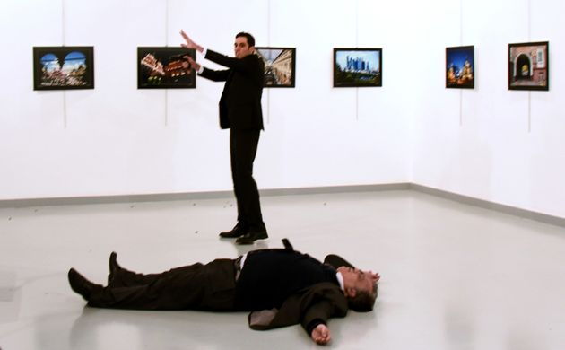 Andrei Karlov (front), the Russian ambassador to Ankara, lies on the floor next to his killer Mevlut...