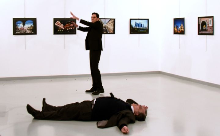Andrei Karlov (front), the Russian ambassador to Ankara, lies on the floor next to his killer Mevlut Mert Altintas who still