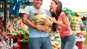 Laughing couple at outdoor market, Curacao