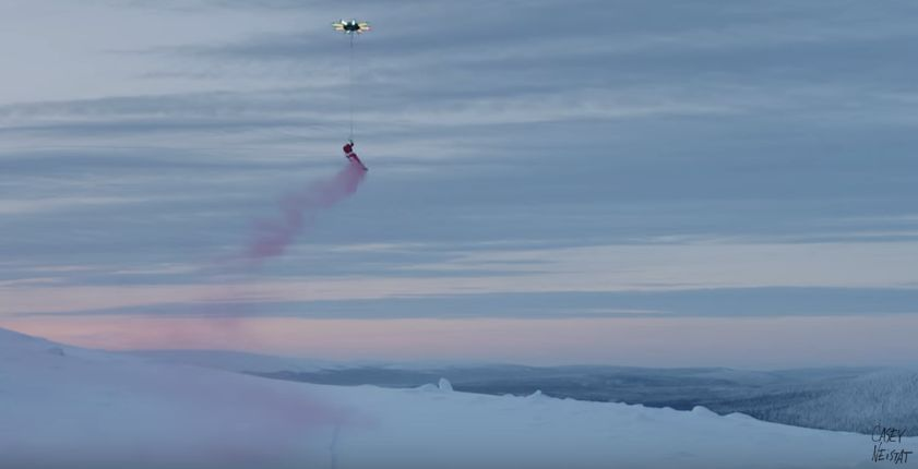 Snowboarder Floats Through The Sky With The Help Of Giant