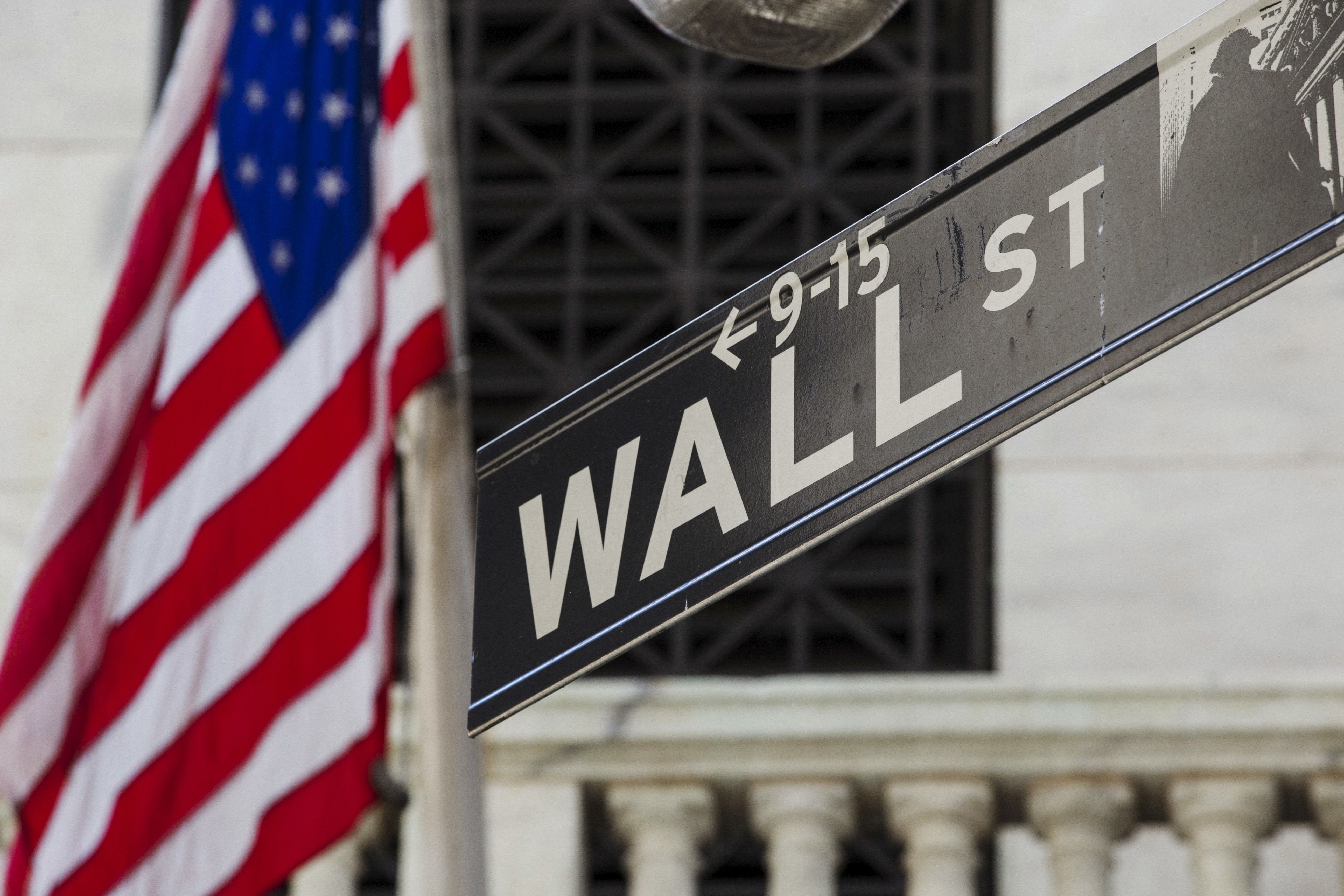 A U.S. flag hangs above the door of the New York Stock Exchange August 26, 2015. Wall Street racked up its biggest one-day gain in four years on Wednesday as fears about China's economy gave way to bargain hunters emboldened by expectations the U.S. Federal Reserve might not raise interest rates next month.   REUTERS/Lucas Jackson