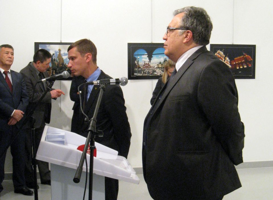 Russian Ambassador to Turkey Andrei Karlov makes a speech at an art gallery shortly before he was shot in Ankara, Turkey, Dec