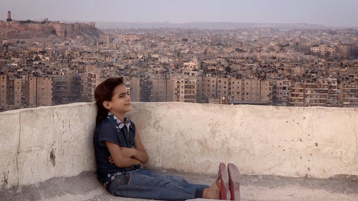 Farah on an Aleppo rooftop, before she and her family fled.