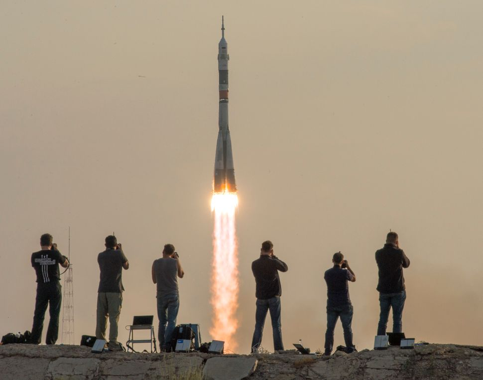 In this handout provided by NASA, the Soyuz MS-01 spacecraft launches from the Baikonur Cosmodrome in Baikonur, Kazakhstan, w