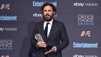 "Casey Affleck poses in the press room with the award for best actor for ""Manchester by the Sea"" at the 22nd annual Critics' Choice Awards at the Barker Hangar on Sunday, Dec. 11, 2016, in Santa Monica, Calif. (Photo by Jordan Strauss/Invision/AP)"