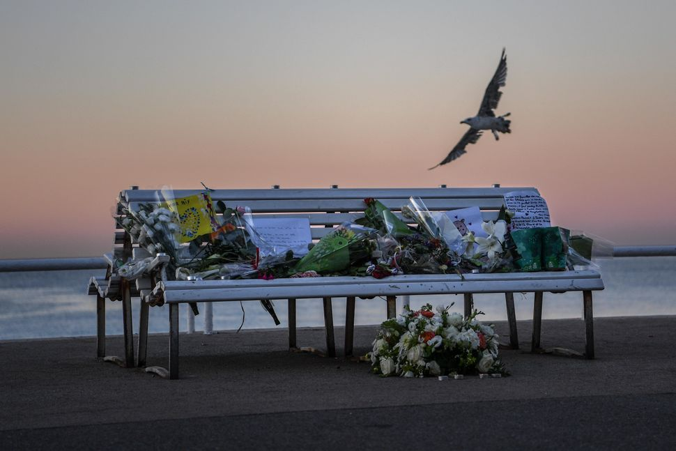 A tribute is laid on a bench where a person was killed on the Promenade des Anglais on July 17 in Nice, France. AFrench