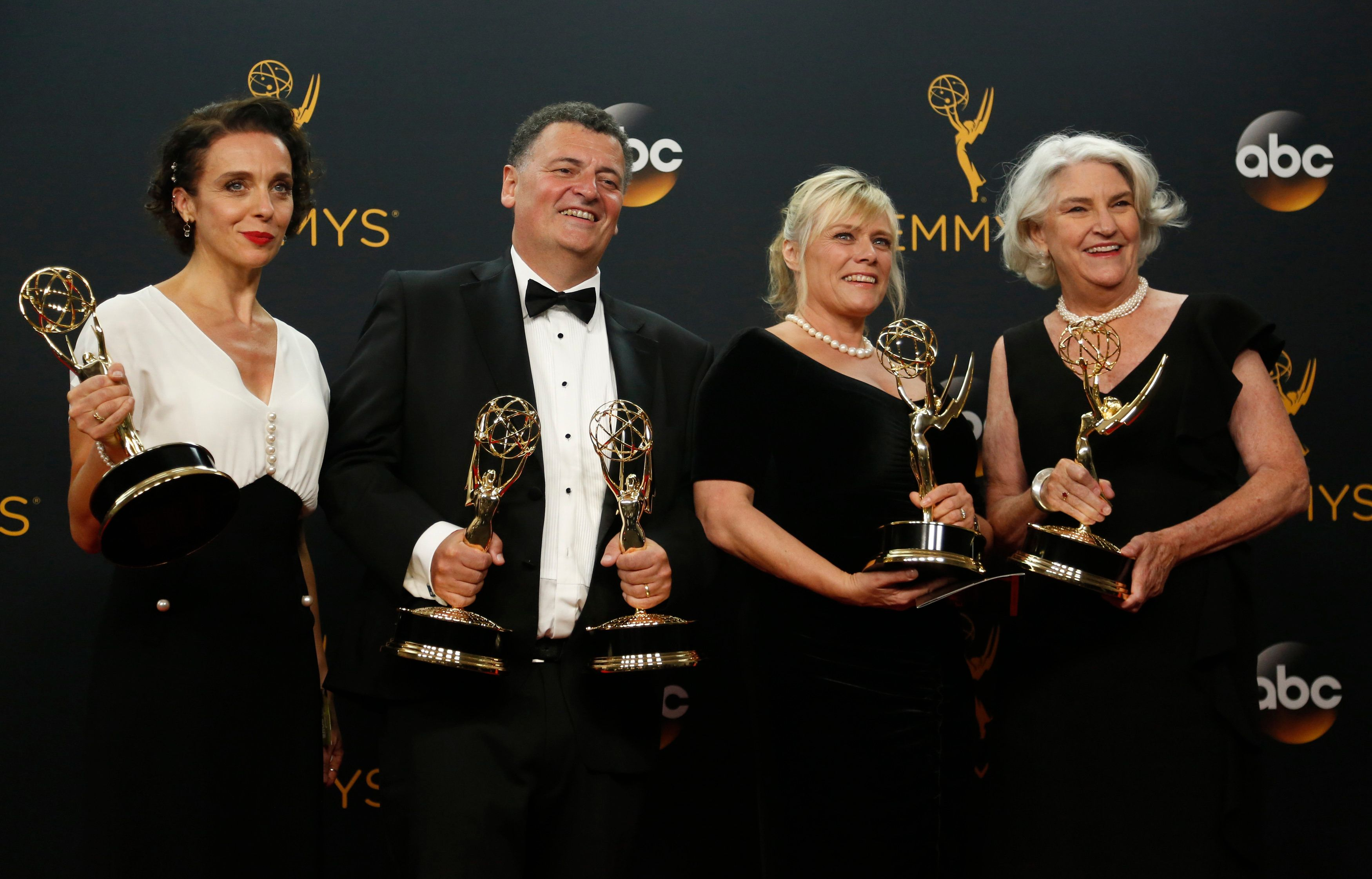 """Actress Amanda Abbington (L), producers Steven Moffat, Sue Verue and Beryl Vertue pose backstage with their award for Outstanding Television Movie for """"Sherlock: The Abominable Bride"""" at the 68th Primetime Emmy Awards in Los Angeles, California U.S., September 18, 2016.  REUTERS/Mario Anzuoni"""