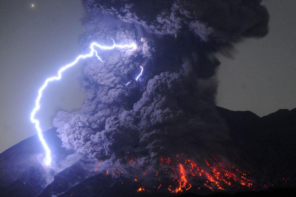 A thunderstorm occurs over Mount Sakurajima as the volcano erupts violently at 12:03 a.m. on July 26 in Tarumizu, Kagoshima,