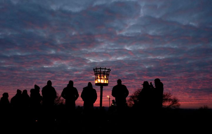 The Charnwood Grove of Druids gather for a public winter solstice ritual on Beacon Hill near Loughborough, Britain December 1