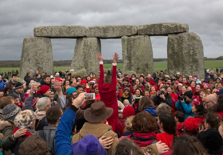 Revelers celebrate the winter solstice at Stonehenge on December 22, 2015. Stonehenge is a celebrated venue of festiviti