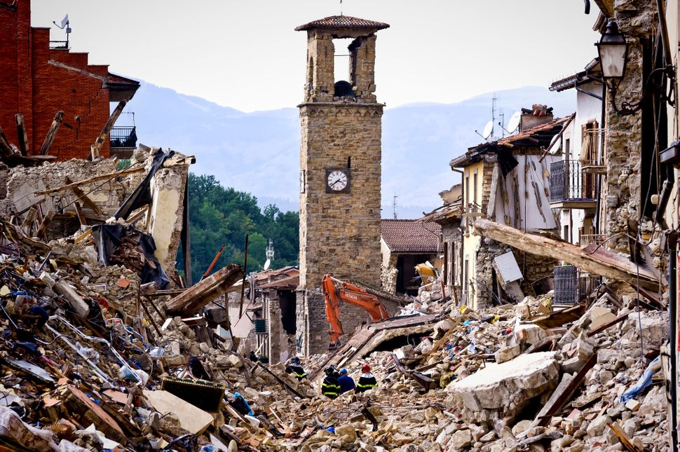 Firefighters continue removing rubble near the bell tower in Amatrice, Italy, on Aug.30. Italy was struck by a powerful