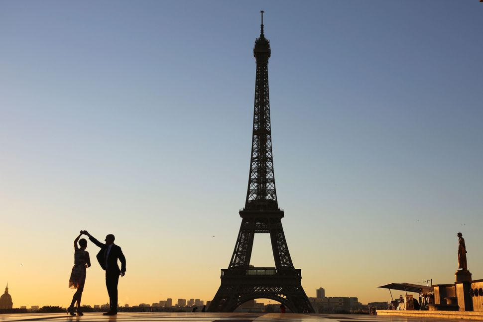 A couple dances at sunrise on Oct. 6 on the Trocadero plaza in front of the Eiffel Tower in Paris.