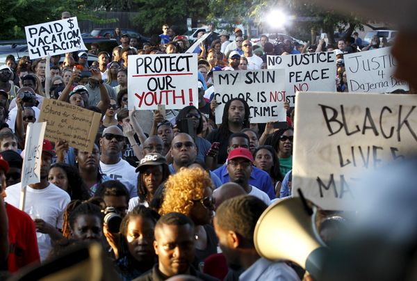 Protestors listen during a rally against what demonstrators call police brutality in McKinney, Texas June 8, 2015. Hundreds m