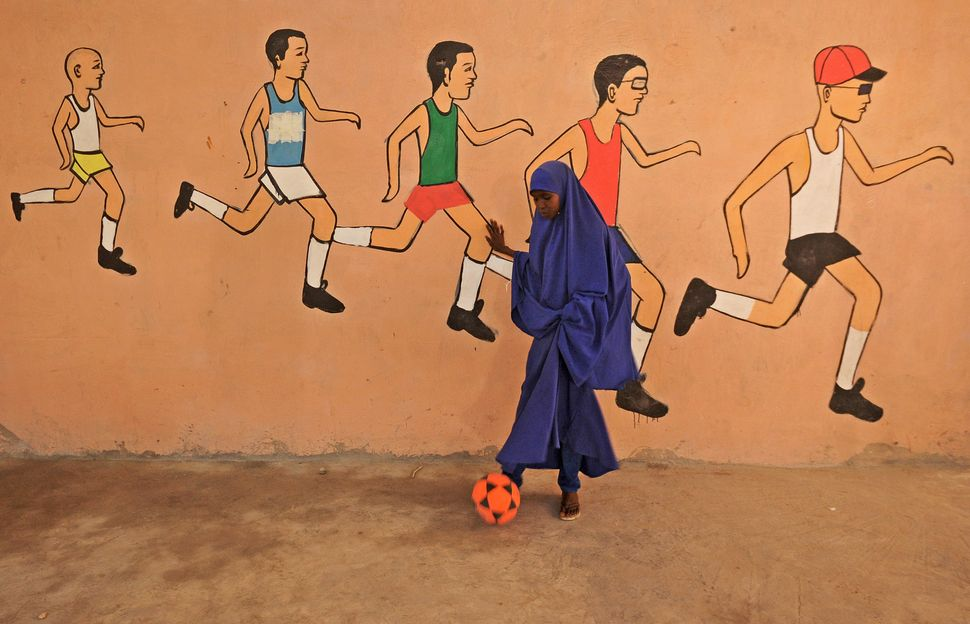 A school pupil kicks a ball during a sports lesson at a school in Mogadishu on Dec. 6.