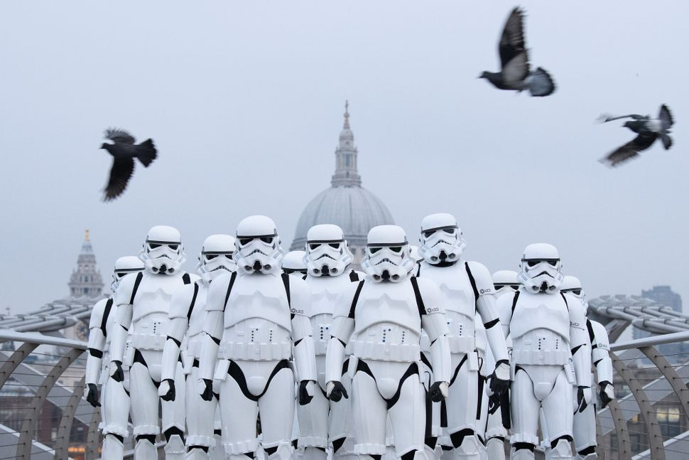 People dressed as stormtroopers from the Star Wars franchise of films pose on the Millennium Bridge to promote the latest rel