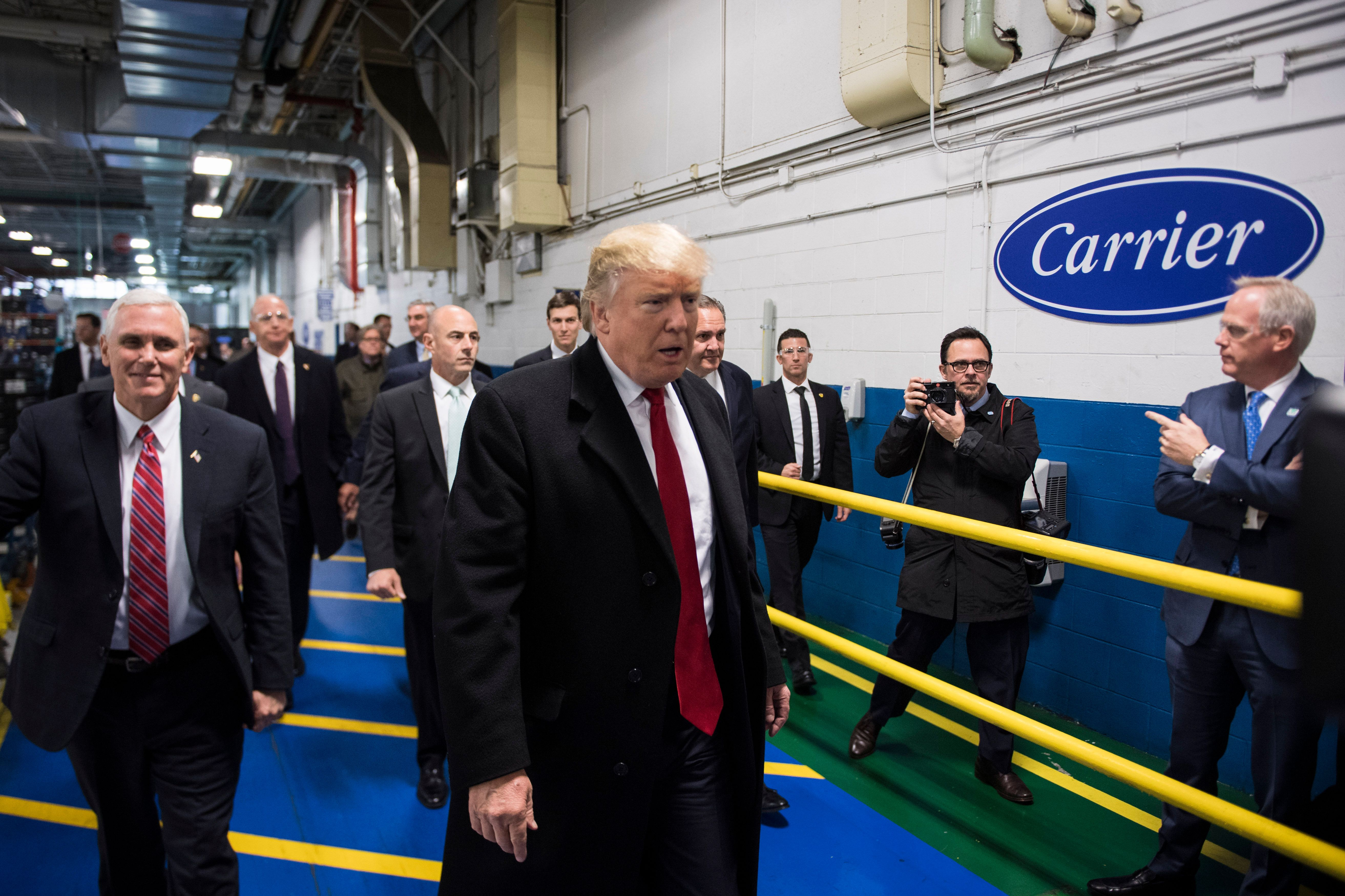 INDIANAPOLIS, IN - DECEMBER 1: President-elect Donald Trump and Vice President-elect Mike Pence take a tour of Carrier Corporation in Indianapolis, IN on Thursday, Dec. 01, 2016. (Photo by Jabin Botsford/The Washington Post via Getty Images)