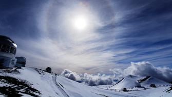 The halo is an optical phenomenon produced by ice crystals creating colored or white arcs and spots in the sky.Many are appear near the sun or moon.