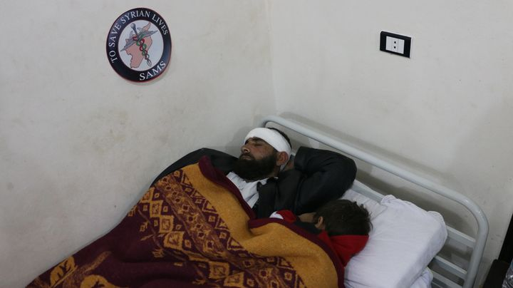 Mohamed*, an evacuated patient, and his son rest at a Syrian American Medical Society facility in Idlib, Syria.
