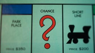 The 'Chance' square is seen on a Hasbro Inc. Monopoly board game arranged for a photograph taken with a tilt-shift lens in Oradell, New Jersey, U.S., on Sunday, June 28, 2015. Photographer: Ron Antonelli/Bloomberg via Getty Images