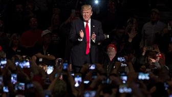 U.S. President-elect Donald Trump arrives to speak during an event in Des Moines, Iowa, U.S., on Thursday, Dec. 8, 2016. Trump said China will soon have to 'play by the rules' as he introduced governor of Iowa Terry Branstad, the man he intends to nominate as his emissary to the U.S.s largest economic rival and most important trading partner. Photographer: Daniel Acker/Bloomberg via Getty Images