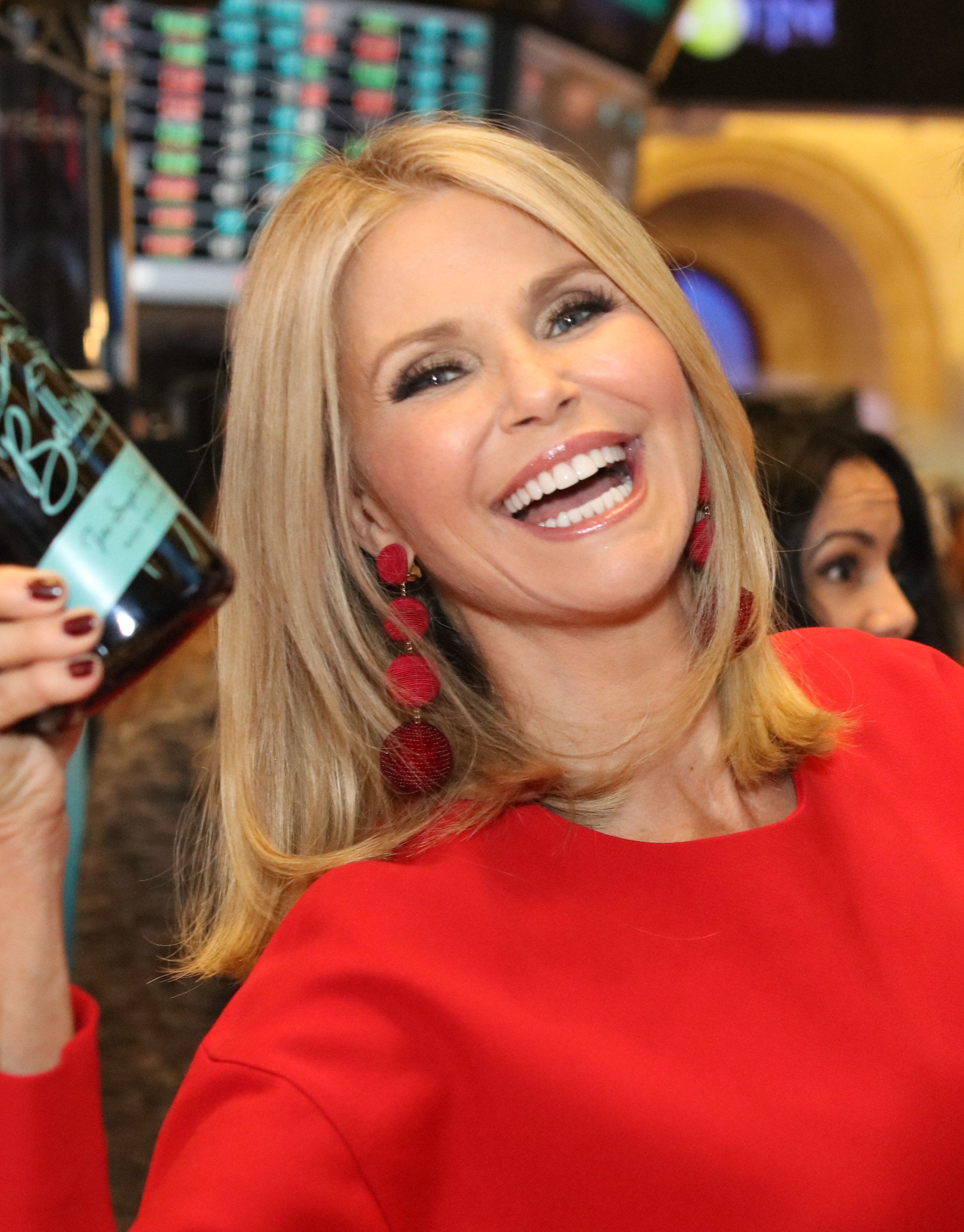 NEW YORK, NY - DECEMBER 01:  (EXCLUSIVE COVERAGE) Model, actress and entrepreneur Christie Brinkley poses on the trading floor after ringing the closing bell for the launch of her new Prosecco, Bellisima during the 93rd annual lighting of the NYSE Christmas Tree at the New York Stock Exchange on December 1, 2016 in New York City.  (Photo by Myrna M. Suarez/FilmMagic)