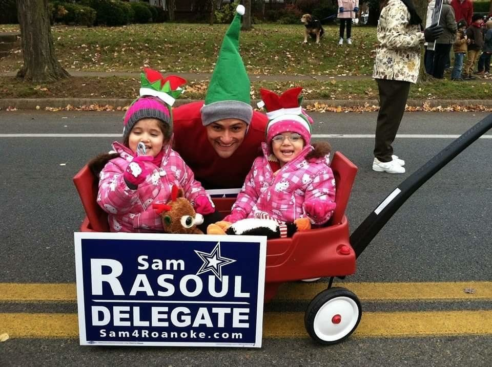 Sam Rasoul poses with his children in holiday costumes.