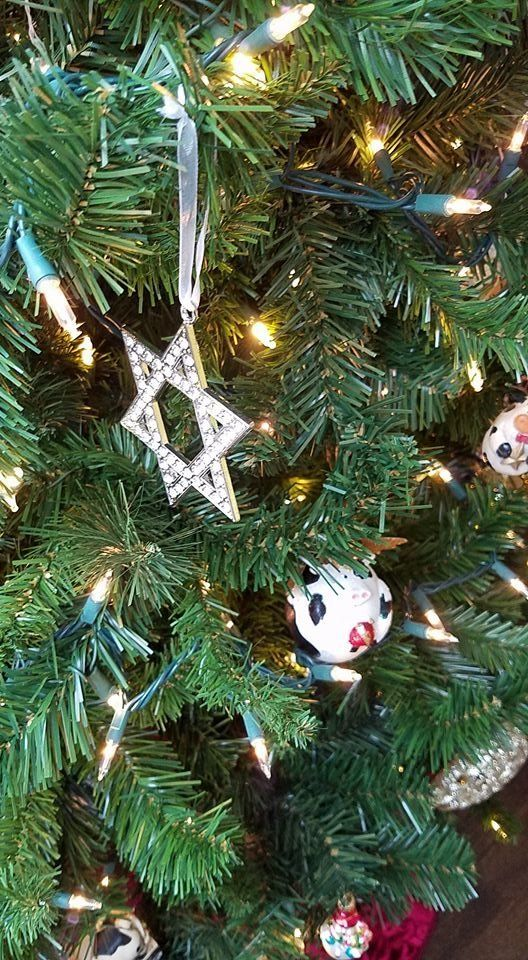 Askar's interfaith tree comes adorned with relics of many religions.