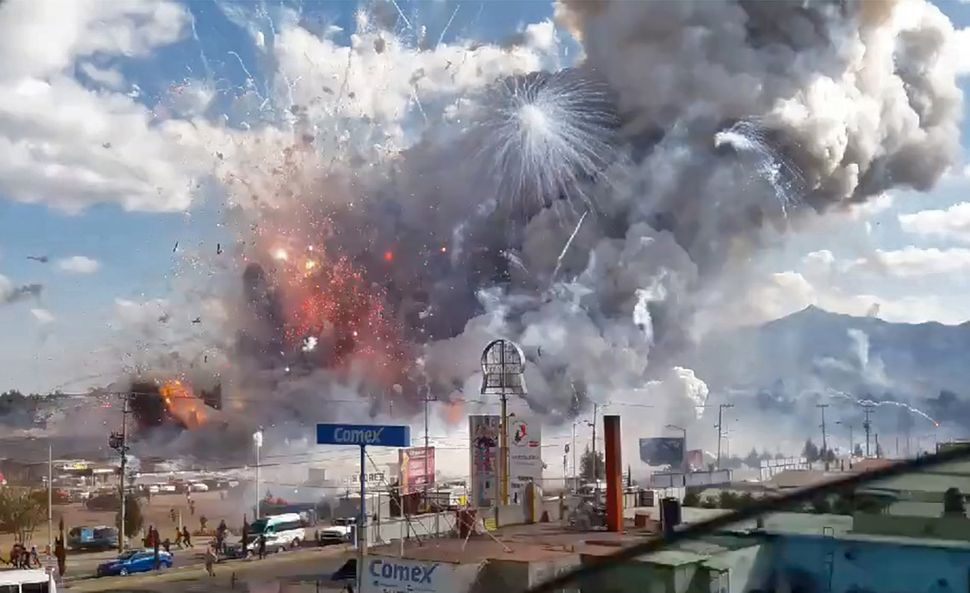 A massive explosion guts Mexico's biggest fireworks market near Mexico City on Dec. 20.